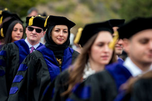 students walking into commencement ceremony at Pepperdine University